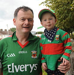 Mayo supporters Colin Flynn with his son Iarlaith from Ballyhaunis on their way to the Gaelic grounds.<br />