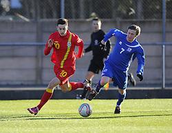 Tom Lawrence (Manchester United) of Wales battles for the ball with Andi Rafn Yeoman (Breidablik) of Iceland - Photo mandatory by-line: Joe Meredith/JMP - Tel: Mobile: 07966 386802 06/02/2013 - SPORT - FOOTBALL - Stebonheath Park - Llanelli -  Wales U21s V Iceland U21s - U21s International friendly