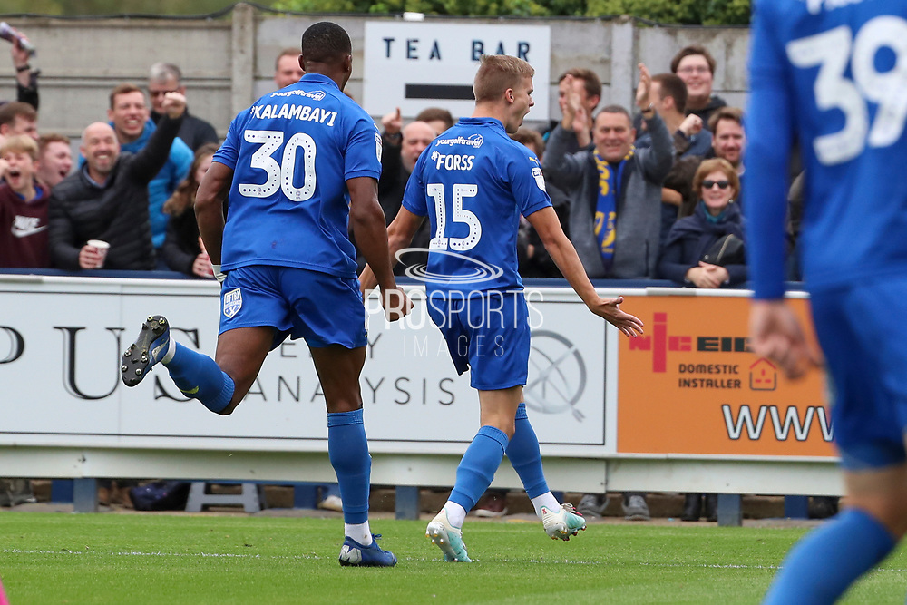 AFC Wimbledon attacker Marcus Forss (15) celebrating after scoring goal to make it 1-0 during the EFL Sky Bet League 1 match between AFC Wimbledon and Rochdale at the Cherry Red Records Stadium, Kingston, England on 5 October 2019.