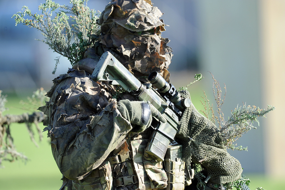 Police AOS sniper (Armed Offenders Squad) take part in a public display to celebrate 50 years of the AOS at the Royal Police College, Porirua, New Zealand, Saturday, August 09, 2014. Credit:SNPA / Ross Setford