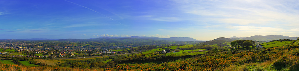 ~180 degree view from Bernish Viewpoint near Newry which can be seen in the foreground to the left. The A1 sweeps passed it on its way south, drawing the eye to the Mourne Mountains, Carlingford Lough and the Cooley Mountains.