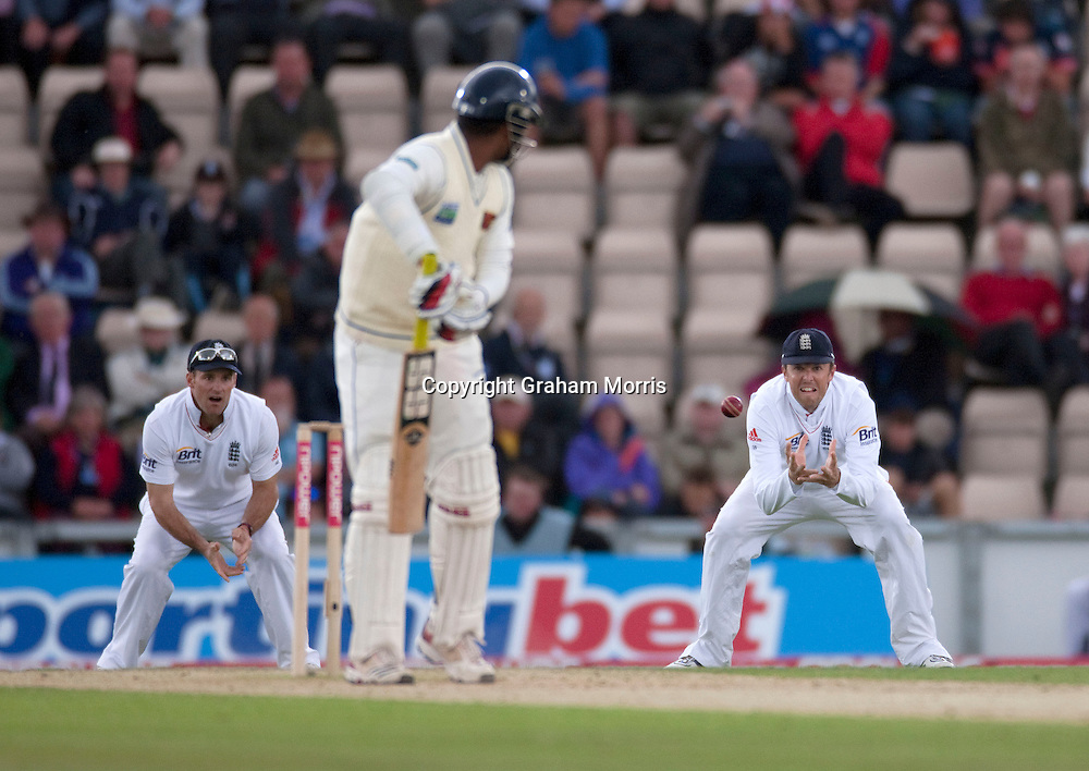 Captain Andrew Strauss (left) watches as Graeme Swann catches Tharanga Paranavitana off the bowling of James Anderson during the third npower Test Match between England and Sri Lanka at the Rose Bowl, Southampton.  Photo: Graham Morris (Tel: +44(0)20 8969 4192 Email: sales@cricketpix.com) 19/06/11