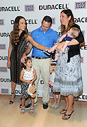 Hilary Swank, left, actress and daughter of a retired Air Force Senior Master Sergeant, greets Robert and Denise Nilson and their children, the military family that inspired the new Duracell film, The Teddy Bear, Thursday, July 2, 2015, at The Times Center in New York.   The film was released in time for the July Fourth holiday weekend and can be viewed at youtube.com/Duracell. (Photo by Diane Bondareff/Invision for Duracell/AP Images)