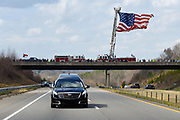 The Newton Fire Dept. raises a huge American flag at an overpass of Route 321, near Newton, N.C. to honor Rev. Billy Graham as his hearse travels from the Billy Graham Training Center at the Cove in Asheville, N.C. to the Billy Graham Library in Charlotte. N.C.on Saturday, Feb. 24, 2018. (AP Photo/Kathy Kmonicek)