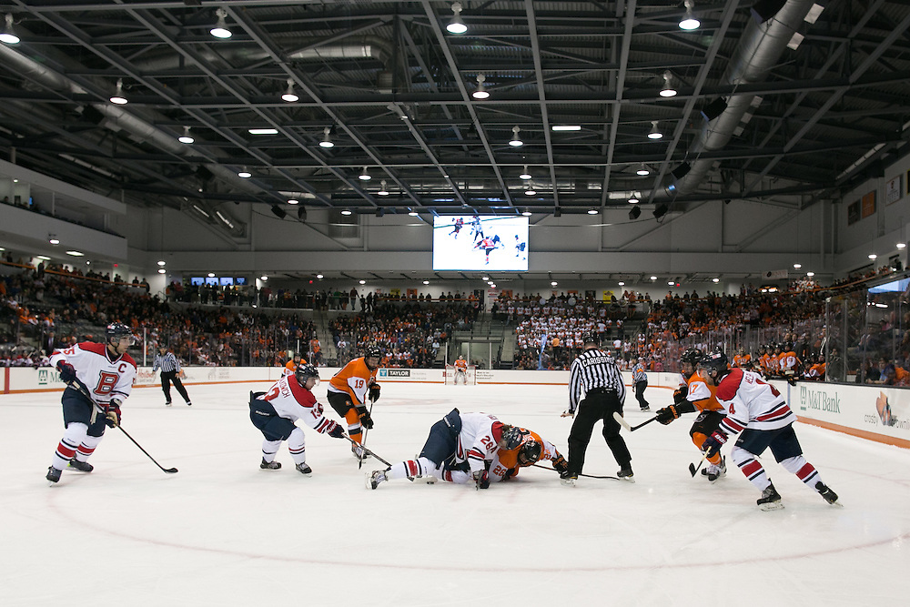 A face-off in RIT's offensive zone during a game against Brock University at the Gene Polisseni Center on Saturday, October 4, 2014.