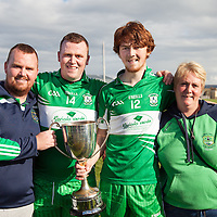 Brenda Leahy, with her Sons Aaron, Gary and Darragh after Wolfe Tone's Intermediate Football Final Reply win against Corofin in Miltown Malbay