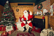 A comical feature showing the diverse and wide variety of Santa Clause's one can find in and around London. Father Christmas seems to have a wide range of appearances and different types of grottos from the elaborate Hamley's Toy Store to a garden shed in a Chobham garden centre. <br /> Pictured - Santa Clause and his grotto at The Rainforest Cafe, Piccadilly Circus, London.<br /> Credit: Rick Findler / Story Picture Agency