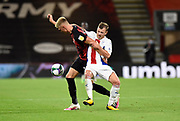 Sam Surridge (14) of AFC Bournemouth is held by Max Meyer (7) of Crystal Palace during the EFL Cup match between Bournemouth and Crystal Palace at the Vitality Stadium, Bournemouth, England on 15 September 2020.