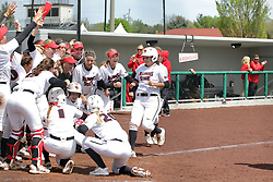 22 April 2017:  The team meets Jordan de los Reyes at home plate after she clears the bases with a 3 run homer over the centerfield wall during a Missouri Valley Conference (MVC) women's softball game between the Missouri State Bears and the Illinois State Redbirds on Marian Kneer Field in Normal IL