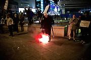 Frankfurt am Main | 02 Feb 2015<br /> <br /> Am Montag (02.02.2015) demonstrierten in Frankfurt an der Hauptwache etwa 60 PEGIDA-Anh&auml;nger mit teils extrem rassistischen Reden und Parolen z.B: gegen &quot;Islamisierung&quot;, an den Aktionen gegen die Rechtsextremisten nahmen mehrere tausend Menschen teil.<br /> Hier: Gegendemonstranten haben einen Pyro zu den PEGIDA-Aktivisten geworfen.<br /> <br /> &copy;peter-juelich.com<br /> <br /> [No Model Release | No Property Release]