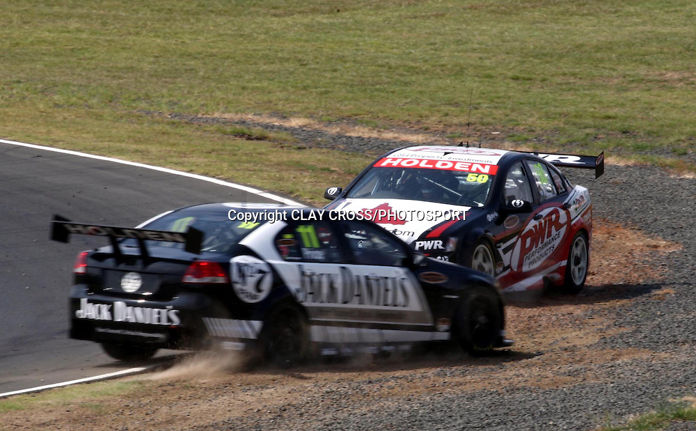 Andrew Thompson of PWR goes off track with Shane Price during the V8 Supercar race at Eastern Creek Raceway, Western Sydney on Saturday 8th March 2008. Photo: Clay Cross/PHOTOSPORT