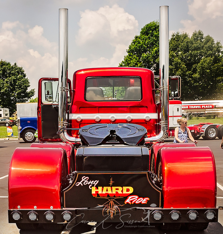 A 1991 Mack RD686, restored by Dickerson Custom Trucks, is shown from the rear at the 34th annual Shell Rotella SuperRigs truck beauty contest, June 11, 2016, in Joplin, Missouri. SuperRigs, organized by Shell Oil Company, is an annual beauty contest for working trucks. Approximately 89 trucks entered this year's competition. The truck received the SuperRigs show truck award. (Photo by Carmen K. Sisson/Cloudybright)