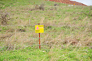 Israel, Golan Heights, an old pre Six Day War minefield with fence and warning signs. On February 6 2010 two Israeli children were seriously injured when they walked into a snow covered minefield