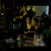 BEIJING, MAY -7, 2012 : models chat backstage before the Guo Pei fashion show ..Guo Pei , 45, is China's answer to haute couture. When she started out 15 years ago, there was no fashion in China .  Since then though  about everything in China has changed. Many more people are able to afford luxury products, and Chinese women, at least those who can afford it, follow international fashion trends. What makes Guo Pei different is what she puts on a runway. She employs 300 people in a workroom two hours from Beijing. She had to train them, but it?s also true that her creative freedom is tethered to relatively cheap labor. One dress alone, made entirely of golden panels, took 50,000 hours to embroider.