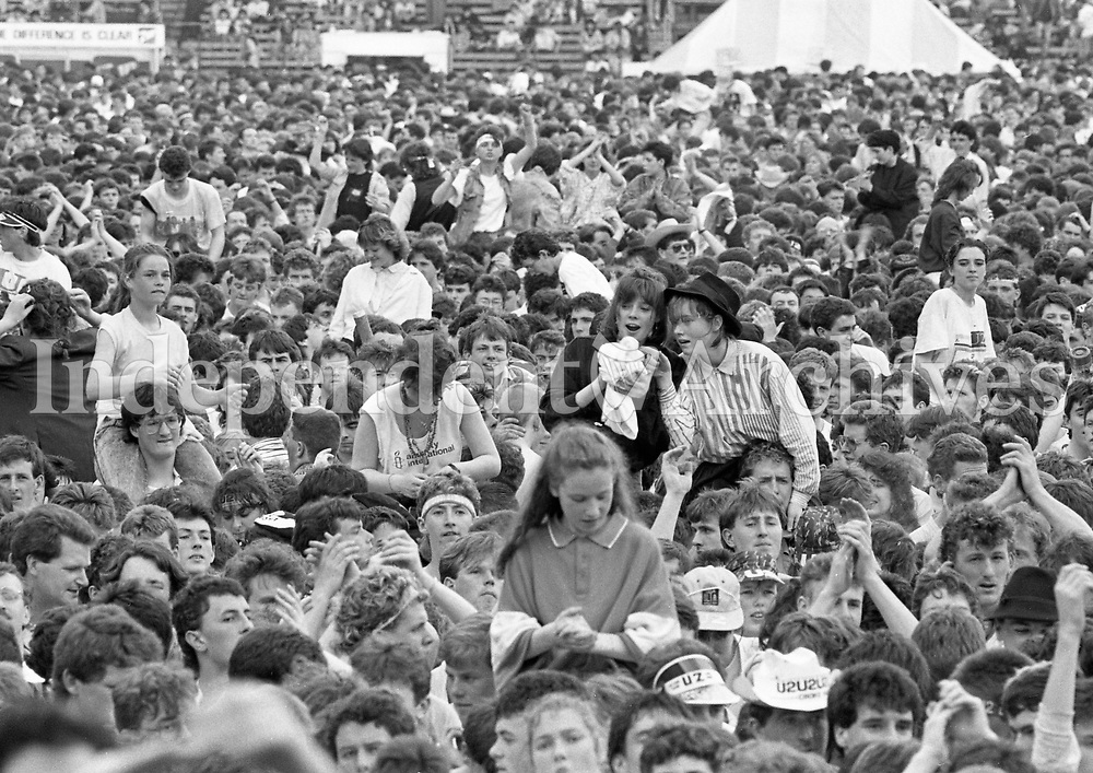 687-637<br /> U2 - The Joshua Tree Tour, 2nd leg: Europe.<br /> Croke Park, Dublin, June 1987.<br /> View of the many fans making up the audience.<br /> Support Acts June 27 1987: Light A Big Fire, The Dubliners, The Pogues, Lou Reed.<br /> Support Acts June 28 1987: Christy Moore, The Pretenders, Lou Reed, Hothouse Flowers.<br /> (Part of the Independent Newspapers Ireland/NLI collection.)