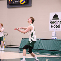 1st year middle blocker Mason Issel (14) of the Regina Cougars in action during Men's Volleyball home game on February 10 at Centre for Kinesiology, Health and Sport. Credit: Arthur Ward/Arthur Images