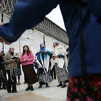 Jewish women of the Women of the Wall organization pray as they dance at the Western Wall,  Judiasm's holiest site in Jerusalem's Old City. Women of the Wall is a group of mostly religiously observant women who believe that women should be allowed to pray as a group at the Western Wall read from a Torah scroll and wear prayer shawls and phylacteries that in orthodox Judaism are used only by men.