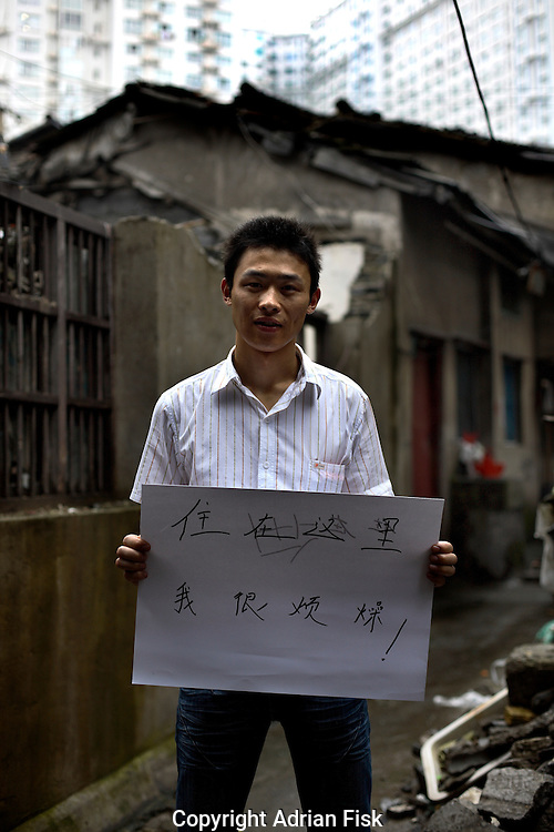 Hu Lin Shuan - 27 Yrs.<br /> Migrant worker as room service boy in hotel.<br /> Shanghai.<br /> <br /> 'Living here I feel frustrated'.
