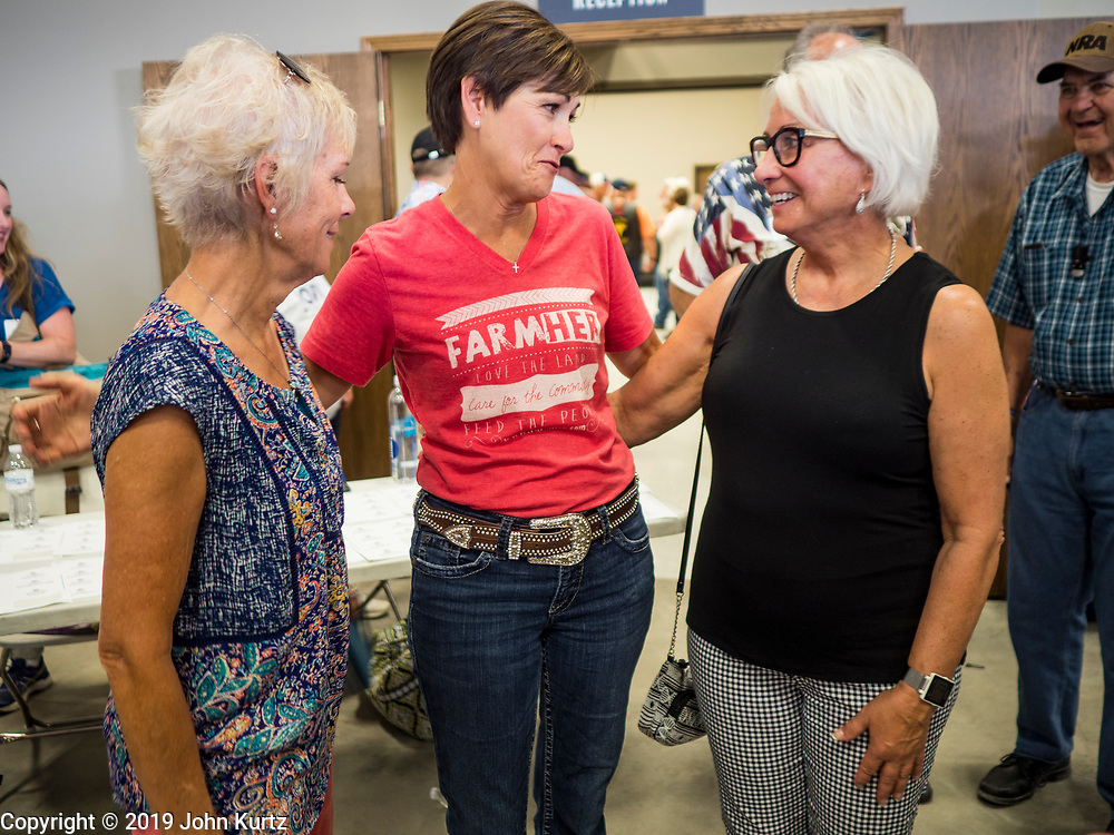 "15 JUNE 2019 - BOONE, IOWA: Governor KIM REYNOLDS (R-IA) talks to Iowa Republicans at ""Joni's Roast and Ride,"" an annual fund raiser held by US Senator Joni Ernst (R-IA). Ernst, Iowa's junior US Senator, kicked off her re-election campaign during the ""Roast and Ride"", an annual fund raiser and campaign event has she held since originally being elected to the US Senate in 2014.   PHOTO BY JACK KURTZ"
