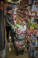 A Chinese woman, visiting Japan, carefully considers which toiletries to purchase.  Relaxed Japanese visa requirements and a weak yen has attracted Chinese tourist.    Tax-free counters have been set up in all the major shopping districts of Tokyo to encourage Chinese tourists to endulge in &quot;bakugai&quot;, or explosive buying.<br /> <br /> Bloomberg says that the average Chinese tourist spends US$2,300/person, 75% higher than tourists from other countries. Meanwhile, Gendai Business reports that the Chinese central government is considering law to set a maximum amount its citizen can spend abroad.<br /> <br /> The Japan National Tourist Agency says that 52% bought over-the-counter drugs and toiletries, often buying in bulk to bring back to China for family members or even for resale.