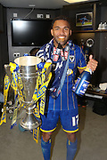 Andy Barcham midfielder for AFC Wimbledon (17) celebrates as AFC Wimbledon win promotion to league 1after the Sky Bet League 2 play off final match between AFC Wimbledon and Plymouth Argyle at Wembley Stadium, London, England on 30 May 2016. Photo by Stuart Butcher.