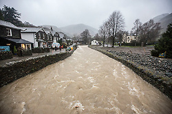 © Licensed to London News Pictures. 22/12/2015. Glenridding UK. Picture shows the beck in Glenridding that is close to breaking it's banks. The village of Glenridding that flooded twice in one week in the last round of bad weather is preparing for more floods after days of heavy rain. Photo credit: Andrew McCaren/LNP