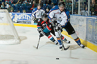 KELOWNA, CANADA, NOVEMBER 25: Zach Franko #9 of the Kelowna Rockets checks John Neibrandt #27 of the Kootenay Ice as the Kootenay Ice visit the Kelowna Rockets  on November 25, 2011 at Prospera Place in Kelowna, British Columbia, Canada (Photo by Marissa Baecker/Shoot the Breeze) *** Local Caption *** Zach Franko; John Neibrandt;