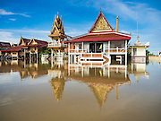 30 SEPTEMBER 2016 - SAI NOI, AYUTTHAYA, THAILAND:  The main prayer hall at the flooded Wat Boonkannawas in Sai Noi. The Chao Phraya River, the largest river that runs through central Thailand, has hit flood stage in several areas in Ayutthaya and Ang Thong provinces. Villages along the river are flooded and farms are losing their crops due to the flood. This is the same area that was devastated by floods in 2011, but the floods this year are not expected to be as severe. The floods are being fed by water released from upstream dams. The water is being released to make room for heavy rains expected in October.     PHOTO BY JACK KURTZ