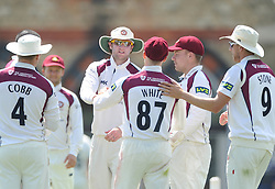Graeme White of Northamptonshire celebrates with team mates as he catches out James Fuller of Gloucestershire - Photo mandatory by-line: Dougie Allward/JMP - Mobile: 07966 386802 - 09/07/2015 - SPORT - Cricket - Cheltenham - Cheltenham College - LV=County Championship 2