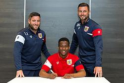 Bristol City Head Coach Lee Johnson and Assistant Head Coach Jamie McAllister look on as Opanin Edwards signs a new contract with Bristol City Under 23s ahead of the 2017/18 Season - Rogan/JMP - 11/07/2017 - Ashton Gate Stadium - Bristol, England.