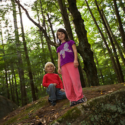 "Kids explore ""The Boulders"" in New Hampshire's Pawtuckaway State Park."