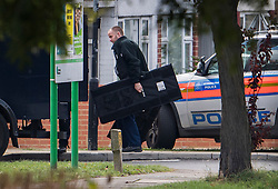 © Licensed to London News Pictures. 22/10/2016. London, UK. A policeman carries a shield in Northolt. Police attended an address in Wood End Lane, Northolt at shortly after 00:50hrs on Friday, 21 October after a report of concerns for the occupant and hazardous items inside the property. Police believe a man is still inside the house. Photo credit: Ben Cawthra/LNP