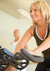 Close up of woman on a gym bike