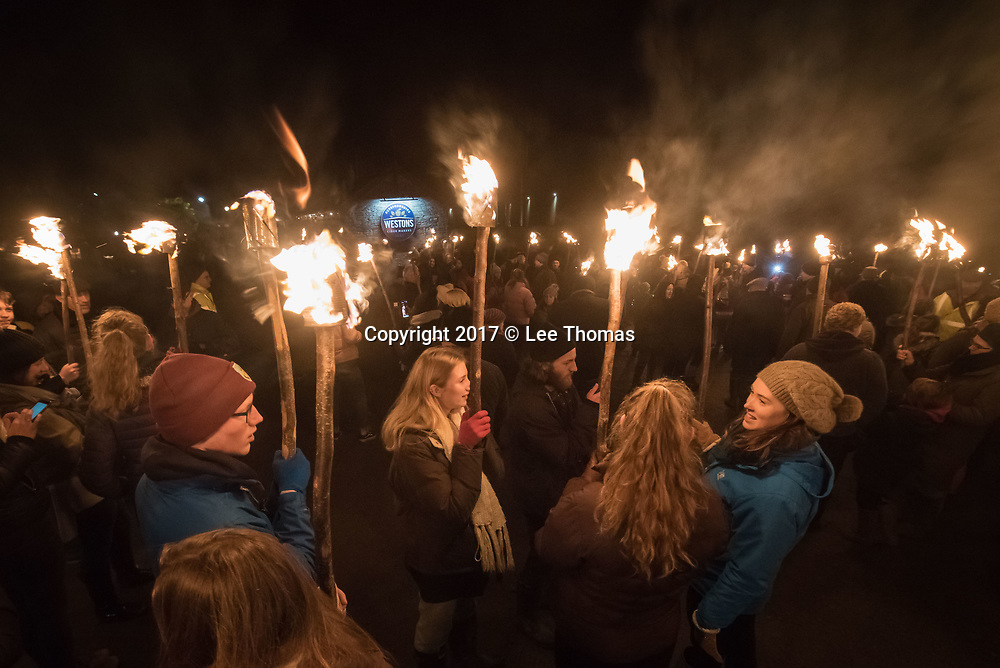 Much Marcle, Herefordshire, UK. 6th January 2018. Pictured:  Crowds of people hold their lit torches before marching off to the orchard. / Hundreds of people both young and old gathered at the Westons Cider Mill and adjoining orchard to take part in the traditional Wassail ceremony. The event at Much Marcle in Herefordshire was attended by the Silurian morris side who entertained the crowd with witty repartee, raucous dancing and music. According to their website, the true origins of blackened faces are lost to history, but are widely believed to be simply a form of disguise, possibly to overcome the oppressive anti-begging laws of the 17th century, and the eternal embarrassment of being a morris man. The orchard-visiting wassail refers to the ancient custom of visiting orchards in cider-producing regions of England, reciting incantations and singing to the trees to promote a good harvest for the coming year.  // Lee Thomas, Tel. 07784142973. Email: leepthomas@gmail.com  www.leept.co.uk (0000635435)