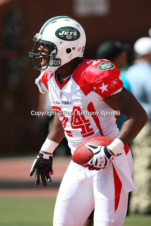 HONOLULU, HI - FEBRUARY 08: AFC All-Stars cornerback Darrelle Revis #24 of the New York Jets celebrates after intercepting an end zone pass intended for wide receiver Anquan Boldin #81 of the Arizona Cardinals of the NFC All-Stars in the 2009 NFL Pro Bowl at Aloha Stadium on February 8, 2009 in Honolulu, Hawaii. The NFC defeated the AFC 30-21. ©Paul Anthony Spinelli *** Local Caption *** Darrelle Revis;Anquan Boldin