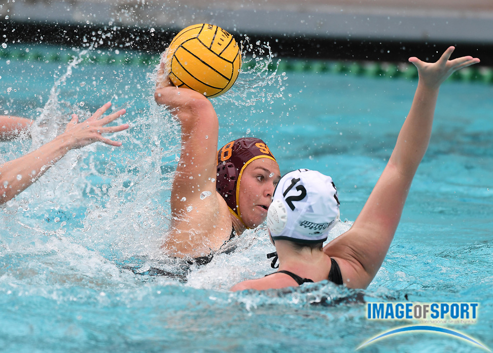Southern California Trojans 2-meter player Kaylee Brownsberge (18) is defended by Wagner Seahawks utility player Kimberly Watson (12) during an NCAA college women's water polo quarterfinal game in Los Angeles, Friday, May 11, 2018. USC defeated Wagner 12-5.  (Kirby Lee via AP)