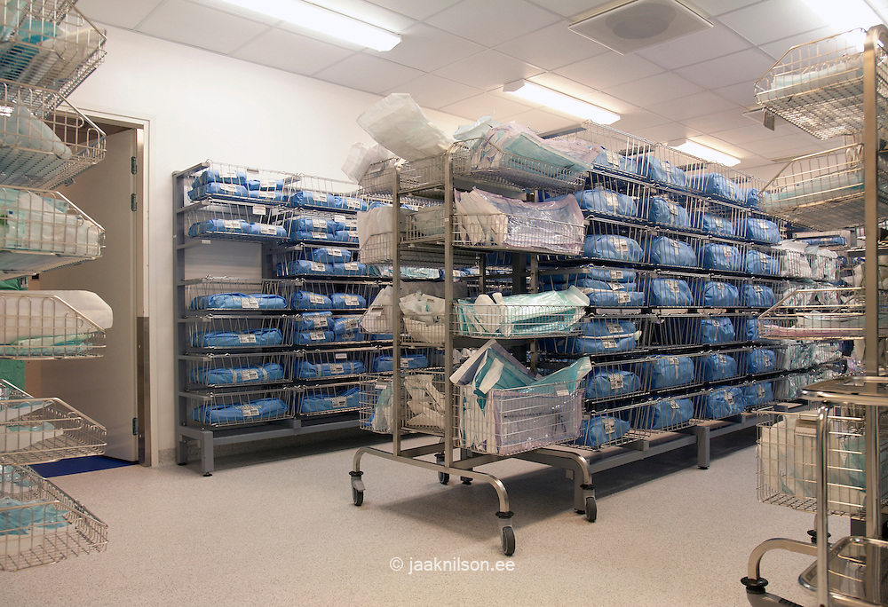Supplies on shelves. Organized, labelled and neatly arranged for efficiency and safety. Sterile wrapped equipment in Tartu university hospital, Estonia