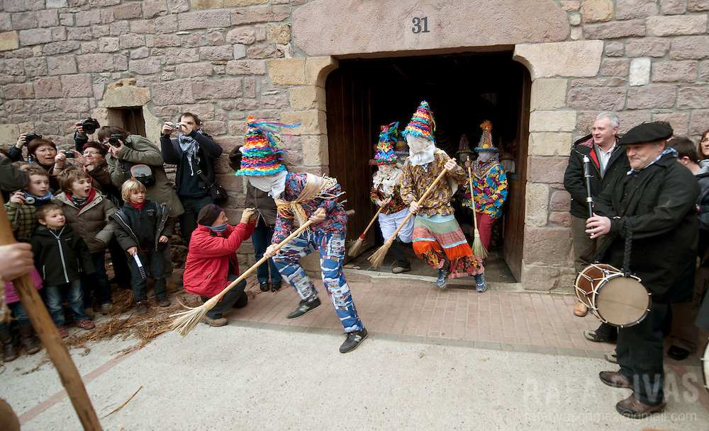 Txatxos come out from a house during the ancient carnival of Lantz, in North of Navarra province in Spain, on March 8, 2011. PHOTO/ RAFA RIVAS