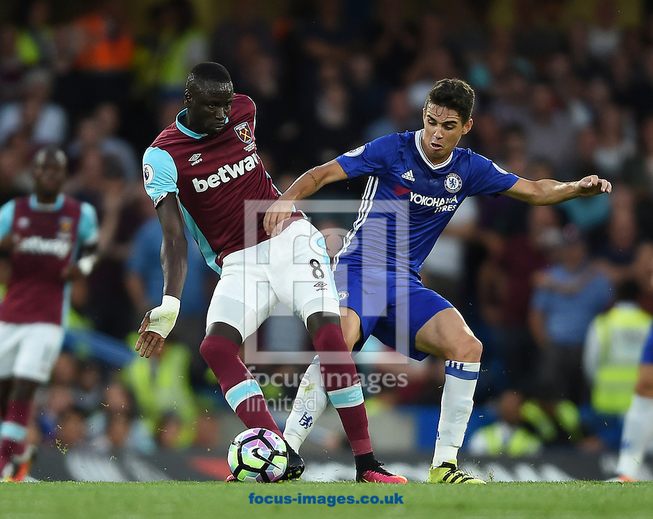 Chelsea's Oscar and Cheikhou Kouyate of West Ham United during the Premier League match at Stamford Bridge, London<br /> Picture by Daniel Hambury/Focus Images Ltd +44 7813 022858<br /> 15/08/2016
