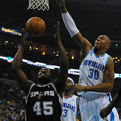 Jan 18, 2010; New Orleans, LA, USA; San Antonio Spurs forward DeJuan Blair (45) shoots as New Orleans Hornets forward David West (30) defends during the first half at the New Orleans Arena. Mandatory Credit: Derick E. Hingle-US PRESSWIRE
