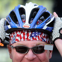 Paul Fuller puts on his helmet before heading out from Turkey Ridge to Irene on Thursday morning during the fifth day of the Tour de Kota.