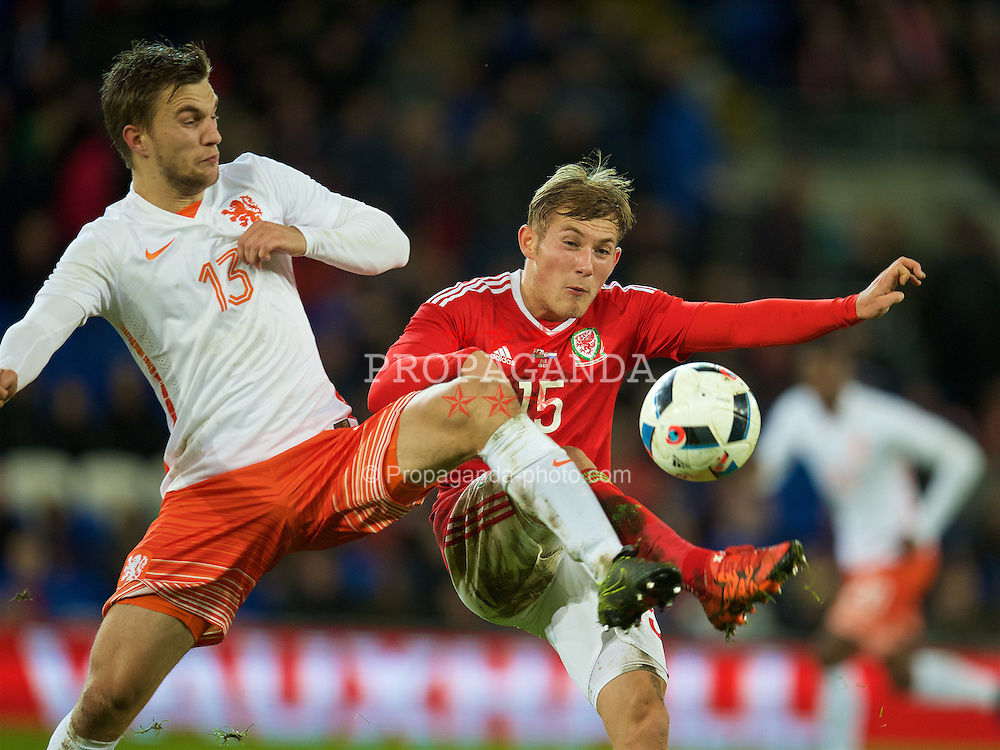 CARDIFF, WALES - Friday, November 13, 2015: Wales' George Williams in action against the Netherlands' Joël Veltman during the International Friendly match at the Cardiff City Stadium. (Pic by David Rawcliffe/Propaganda)