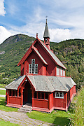 """The red """"new"""" Borgund Parish Church dates from 1866, in Sogn og Fjordane, Norway (and is adjacent to the famous Borgund Stave Church)."""