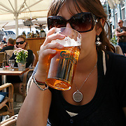 Nyhavn or New Harbor, is a 17th-century waterfront, canal and entertainment district in Copenhagen. Stretching from Kongens Nytorv to the harbor front just south of the Royal Playhouse, it is lined by brightly painted 17th and early 18th century townhouses, bars, cafes and restaurants. <br /> MR Model Release<br /> Photography by Jose More