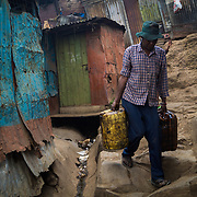 Transporting Oil Through Mathare by Millicent Lodenyi