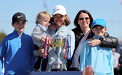 Tommy Fleetwood and family pose after the Betfred British Masters at Hillside Golf Club, Southport.