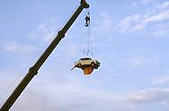 GDR, German Democratic Republic, Berlin, reunification celebration on October 3., 1990, German Unification Day, Trabant car hangs on a crane.....DDR, Deutsche Demokratische Republik, Berlin, Wiedervereinigungsfeier am 3. Oktober 1990, Tag der Wiedervereinigung, Trabi haengt an einem Kran...3. Oktober/October 1990