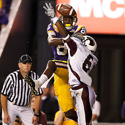 November 13, 2010; Baton Rouge, LA, USA; Louisiana Monroe Warhawks cornerback Robert Nelson (6) breaks up a pass intended for LSU Tigers wide receiver Terrence Toliver (80) during the first half at Tiger Stadium.  Mandatory Credit: Derick E. Hingle