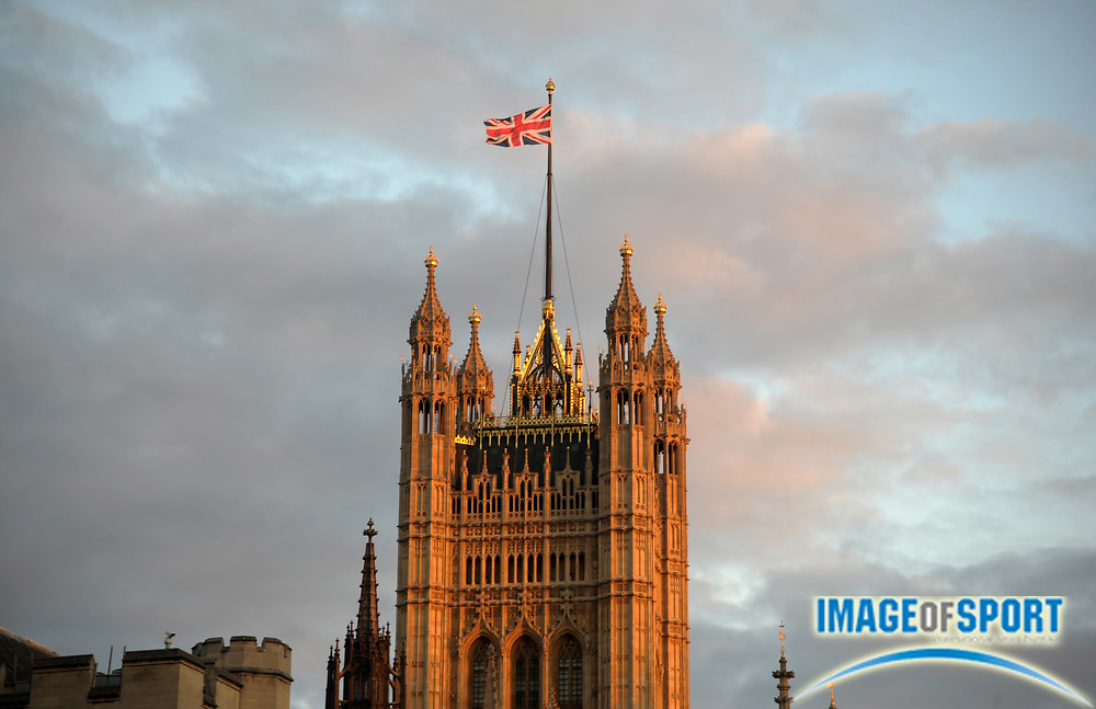 Jul 15, 2012; London, UNITED KINGDOM; General view of a British flag atop the Houses of Parliament and the Palace of Westminster.