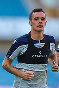 Millwall midfielder Shaun Williams (6) warms down after the EFL Sky Bet Championship match between Millwall and Queens Park Rangers at The Den, London, England on 21 September 2019.